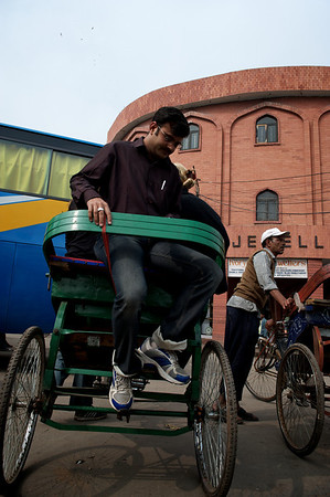 Getting on the back seat of the rickshaw, New Delhi.
