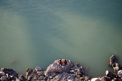 Couple resting at the border of the Ganges, Rishikesh.
