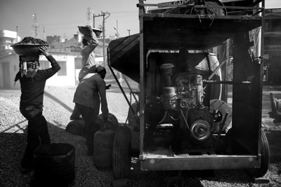 Street workers making asphalt, Haridwar.