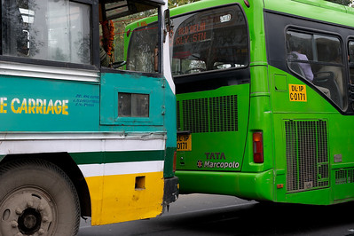 Old and new city busses, New Delhi.