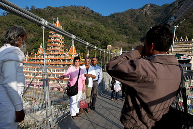 Family photo in front of the Kailash Niketan temple taken on the Lakshman Jhula bridge, Rishikesh.