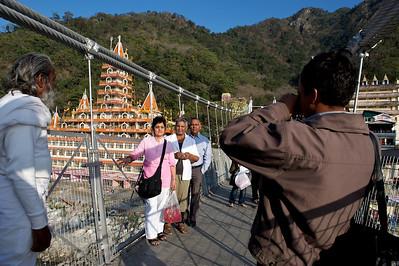 Family photo in front of the Kailash Niketan temple taken on the Lakshman Jhula bridge, Rishikesh.