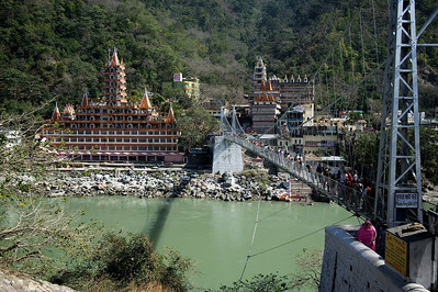View from the German Bakery on the Lakshman Jhula bridge and the Kailash Niketan temple, Rishikesh.