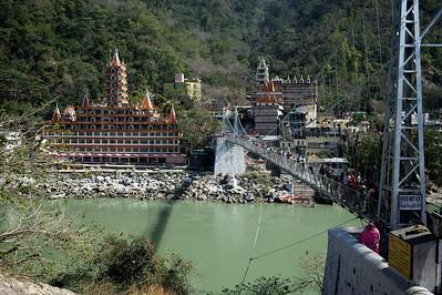 View from the German Bakery on the Lakshman Jhula bridge and the Kailash Niketan temple, Rishikesh.