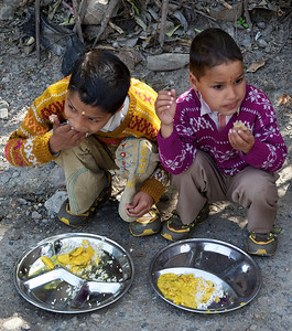 Enjoying free food handed out by an Ashram, Rishikesh.