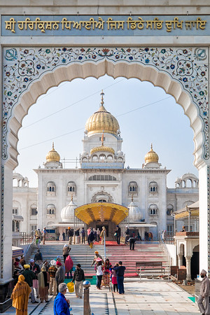 """Gurdwara Bangla Sahib is the most prominent Sikh gurdwara, or Sikh house of worship, in Delhi, known for its association with the eighth Sikh Guru, Guru Har Krishan, and the pool inside its complex, known as the """"Sarovar."""" It was first built as a small temple by Sikh General, Sardar Bhagel Singh in 1783, who supervised the construction of nine Sikh shrines in Delhi in the same year, during the reign of Mughal Emperor, Shah Alam II"""