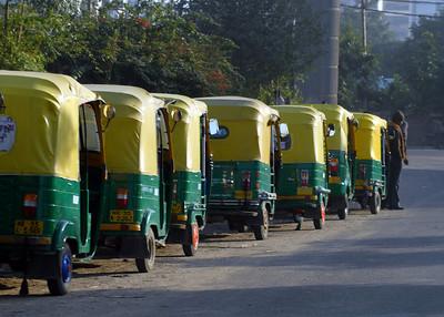 Tuk-tuks (motorized rickshaws) in a row - Gurgaon, December, 2010.