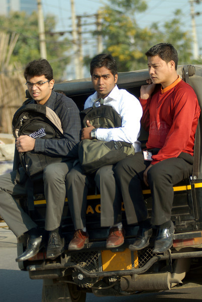 On the way to work in a motorized rickshaw.