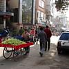 A side street full of life in Delhi.