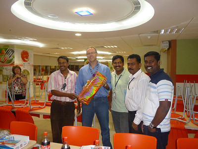 Some of the team and me with the gift