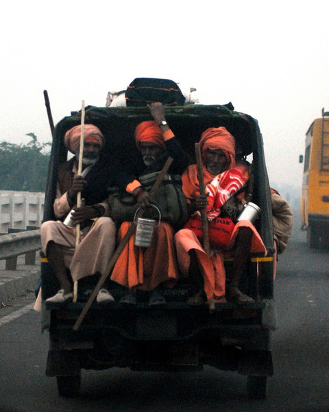 Three monks in a motorized rickshaw.  Shot through the front window of a moving car - difficult to get a crisp image - but worthwhile because of the awesome subjects.