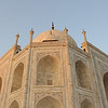 """The Taj Mahal was built on a parcel of land to the south of the walled city of Agra. Shah Jahan presented Maharajah Jai Singh with a large palace in the center of Agra in exchange for the land.[18] An area of roughly three acres was excavated, filled with dirt to reduce seepage and leveled at 50 meters above riverbank. In the tomb area, wells were dug and filled with stone and rubble as the footings of the tomb. Instead of lashed bamboo, workmen constructed a colossal brick scaffold that mirrored the tomb. The scaffold was so enormous that foremen estimated it would take years to dismantle. According to the legend, Shah Jahan decreed that anyone could keep the bricks taken from the scaffold, and thus it was dismantled by peasants overnight. A fifteen kilometer tamped-earth ramp was built to transport marble and materials to the construction site. Teams of twenty or thirty oxen were strained to pull blocks on specially constructed wagons. An elaborate post-and-beam pulley system was used to raise the blocks into desired position. Water was drawn from the river by a series of purs, an animal-powered rope and bucket mechanism, into a large storage tank and raised to large distribution tank. It was passed into three subsidiary tanks, from which it was piped to the complex.<br /> The plinth and tomb took roughly 12 years to complete. The remaining parts of the complex took an additional 10 years and were completed in order of minarets, mosque and jawab and gateway. Since the complex was built in stages, discrepancies exist in completion dates due to differing opinions on """"completion"""". For example, the mausoleum itself was essentially complete by 1643, but work continued on the rest of the complex. Estimates of the cost of the construction of Taj Mahal vary due to difficulties in estimating construction costs across time. The total cost of construction has been estimated to be about 32 million Rupees at that time which now runs into trillions of Dollars if converted to pr"""