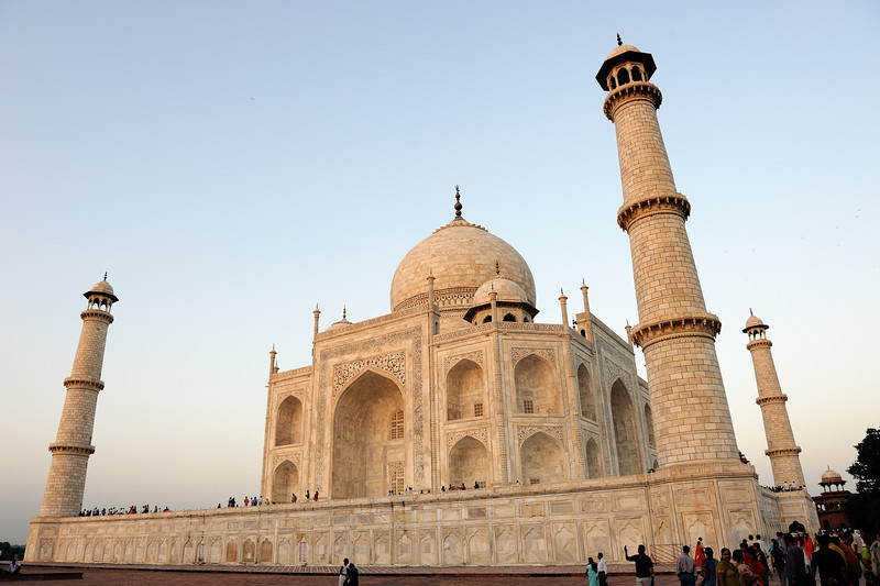 Soon after the Taj Mahal's completion, Shah Jahan was deposed by his son Aurangzeb and put under house arrest at nearby Agra Fort. Upon Shah Jahan's death, Aurangzeb buried him in the Taj Mahal next to his wife.<br /> By the late 19th century, parts of the Taj Mahal had fallen badly into disrepair. During the time of the Indian rebellion of 1857, the Taj Mahal was defaced by British soldiers and government officials, who chiseled out precious stones and lapis lazuli from its walls. At the end of 19th century British viceroy Lord Curzon ordered a massive restoration project, which was completed in 1908. He also commissioned the large lamp in the interior chamber, modeled after one in a Cairo mosque. During this time the garden was remodeled with British-looking lawns that are visible today.<br /> In 1942, the government erected a scaffolding in anticipation of an air attack by German Luftwaffe and later by Japanese Air Force. During the India-Pakistan wars of 1965 and 1971, scaffoldings were again erected to mislead bomber pilots[1]. Its recent threats have come from environmental pollution on the banks of Yamuna River including acid rain due to the Mathura oil refinery, which was opposed by Supreme Court of India directives. In 1983, the Taj Mahal was designated a UNESCO World Heritage Site.