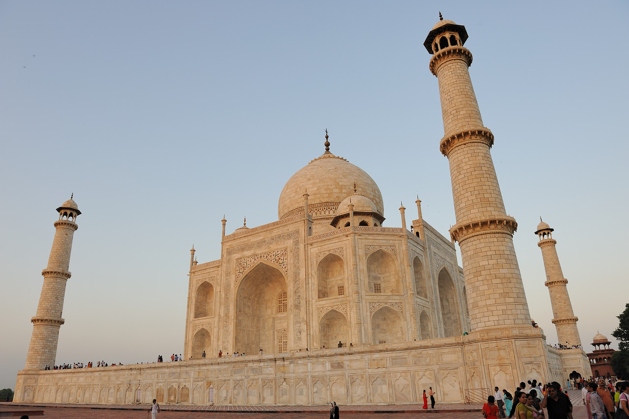 The Taj Mahal attracts from 2 to 4 million visitors annually, with more than 200,000 from overseas. Most tourists visit in the cooler months of October, November and February. Polluting traffic is not allowed near the complex and tourists must either walk from carparks or catch an electric bus. The Khawasspuras (northern courtyards) are currently being restored for use as a new visitor centre.[25][26] The small town to the south of the Taj, known as Taj Ganji or Mumtazabad, originally was constructed with caravanserais, bazaars and markets to serve the needs of visitors and workmen.[27] Lists of recommended travel destinations often feature the Taj Mahal, which also appears in several listings of seven wonders of the modern world, including the recently announced New Seven Wonders of the World, a recent poll[28] with 100 million votes<br /> The grounds are open from 6 am to 7pm weekdays, except for Friday when the complex is open for prayers at the mosque between 12 noon and 2 pm. The complex is open for night viewing on the day of the full moon and two days before and after [2], excluding Fridays and the month of Ramzan. For security reasons [29] only five items - water in transparent bottles, small video cameras, still cameras, mobile phones and small ladies' purses - are allowed inside the Taj Mahal.
