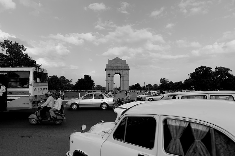"""The India Gate is one of the largest war memorials in India. Situated in the heart of New Delhi, India Gate is prominent landmark in Delhi and commemorates the members of the erstwhile British Indian Army who lost their lives fighting for the Indian Empire in World War I and the Afghan Wars. Following India's independence, India Gate became the site of Indian Army's Tomb of the Unknown Soldier, known as the Amar Jawan Jyoti.Burning in a shrine under the arch of India Gate since 1971 is the Amar Jawan Jyoti (the flame of the immortal warrior), which marks the Tomb of the Unknown Soldier. The shrine itself is a black marble cenotaph with a rifle placed on its barrel, crested by a soldier's helmet. Each face of the cenotaph has inscribed in gold the words """"Amar Jawan"""" (Immortal Warrior). This cenotaph is itself placed on an edifice which has on its four corners four torches that are perpetually kept alive. It was unveiled on January 26, 1972 by the then Prime Minister Indira Gandhi, in the wake of the 1971 Indo-Pak War. Today, it is customary for the President and the Prime Minister, as well as visiting Guests of State, to pay homage at the site on occasions of State ceremonies."""