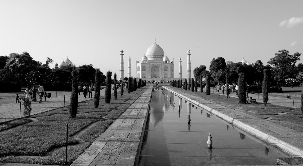 The exterior decorations of the Taj Mahal are among the finest to be found in Mughal architecture. As the surface area changes, a large pishtaq has more area than a smaller one, and the decorations are refined proportionally. The decorative elements were created by applying paint or stucco, or by stone inlays or carvings. In line with the Islamic prohibition against the use of anthropomorphic forms, the decorative elements can be grouped into either calligraphy, abstract forms or vegetative motifs.<br /> The calligraphy found in Taj Mahal are of florid thuluth script, created by Persian calligrapher Amanat Khan, who signed several of the panels. The calligraphy is made by jasper inlaid in white marble panels, and the work found on the marble cenotaphs in the tomb is extremely detailed and delicate. Higher panels are written slightly larger to reduce the skewing effect when viewing from below. Throughout the complex, passages from the Qur'an are used as decorative elements. Recent scholarship suggests that Amanat Khan chose the passages as well.[9][10] The texts refer to themes of judgment and include: