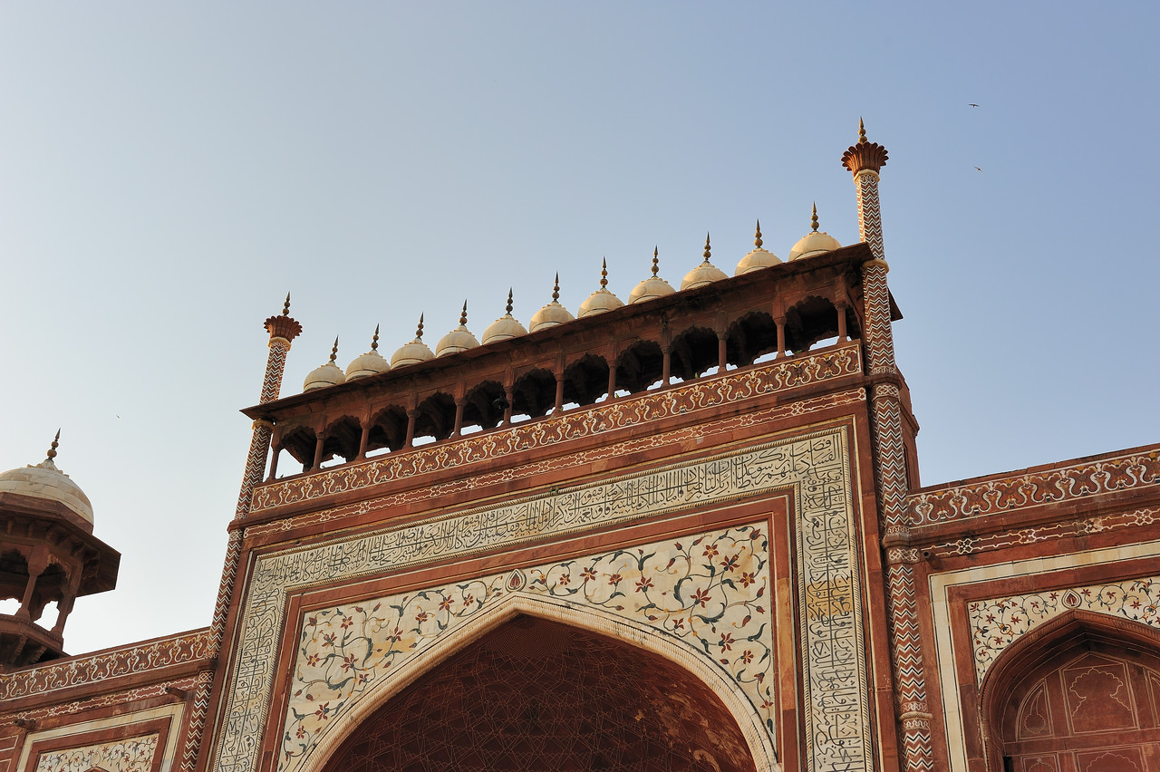 In 1631, Shah Jahan, emperor during the Mughal empire's period of greatest prosperity, was griefstricken when his third wife, Mumtaz Mahal, died during the birth of their fourteenth child, Gauhara Begum.[2] The court chronicles of Shah Jahan's grief illustrates the love story traditionally held as an inspiration for Taj Mahal.[3] [4] The construction of Taj Mahal begun soon after Mumtaz's death with the principal mausoleum completed in 1648. The surrounding buildings and garden were finished five years later. Emperor Shah Jahan himself described the Taj in these words:[5]<br /> Should guilty seek asylum here,<br /> Like one pardoned, he becomes free from sin.<br /> Should a sinner make his way to this mansion,<br /> All his past sins are to be washed away.<br /> The sight of this mansion creates sorrowing sighs;<br /> And the sun and the moon shed tears from their eyes.<br /> In this world this edifice has been made;<br /> To display thereby the creator's glory.<br /> <br /> <br /> Tomb of Humayun shares architectural similarities with the Taj Mahal<br /> The Taj Mahal incorporates and expands on design traditions of Persian and earlier Mughal architecture. Specific inspiration came from successful Timurid and Mughal buildings including the Gur-e Amir (the tomb of Timur, progenitor of the Mughal dynasty, in Samarkand),[6] Humayun's Tomb, Itmad-Ud-Daulah's Tomb (sometimes called the Baby Taj), and Shah Jahan's own Jama Masjid in Delhi. While earlier Mughal buildings were primarily constructed of red sandstone, Shah Jahan promoted the use of white marble inlaid with semi-precious stones, and buildings under his patronage reached new levels of refinement.[7]