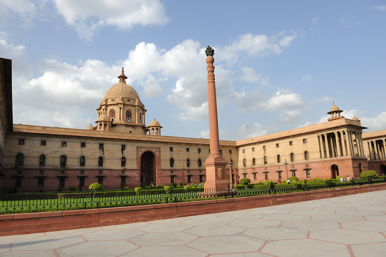The Secretariat Building was designed by the prominent British architect Herbert Baker. The building adopts from Moghul and Rajputana style of architecture. Examples include the use of Jali - decorated stone screens, Chajja - screens slanting outside from a building to protect from scorching sun and monsoon rains of India. Another feature of the building is a dome-like structure known as the Chatri, a design unique to India, used in ancient times to give relief to travelers by providing shade from the hot Indian sun.<br /> The style of architecture used in Secretariat Building is unique to Raisina Hill.