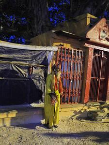 Monk greets sunrise in Varanasi