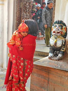 Came for a blessing but added eye shadow to protect the child from the evil eye.