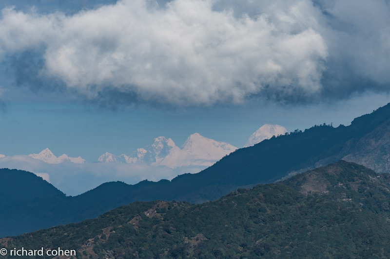 First view of Everest, framed on either side by two other top ten peaks, Lhotse on left and Makalu on right.