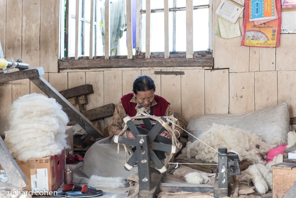 Tibetan woman spinning wool.