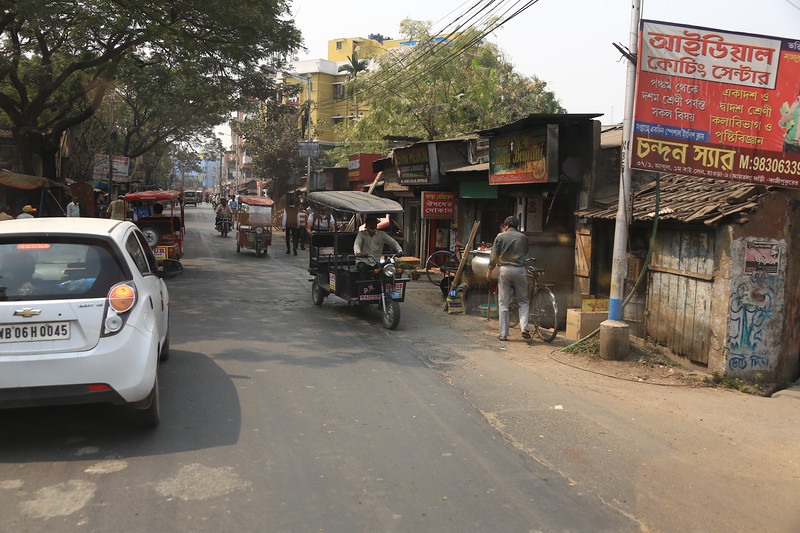 Typical street scene.  This vehicle would be called an auto rickshaw.<br /> EN8A4243