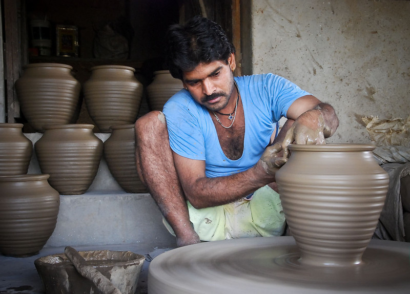 This guy was effortlessly throwing these pots, chatting to us, and looking after his infant child sitting beside him.