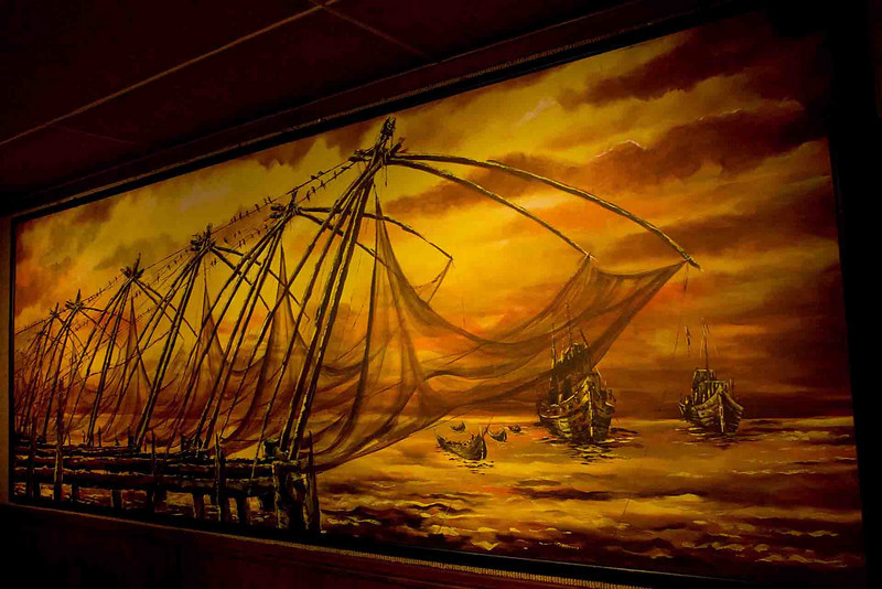 A stylized depiction of Chinese fishing nets. Chinese fishing nets were brought to India by Kubla Khan traders around 1400 AD. They are the unofficial symbol of Cochin. (They work by cantilevers with heavy counterweights. They're operated by a crew of four.)