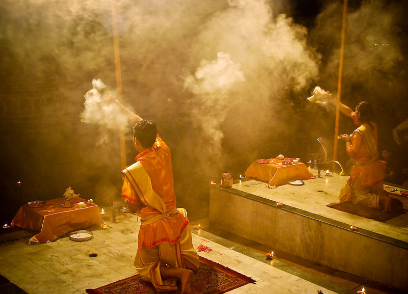 Evening Arati ceremony with young Brahmin priests performing the ritual worship of the Mother Ganges.