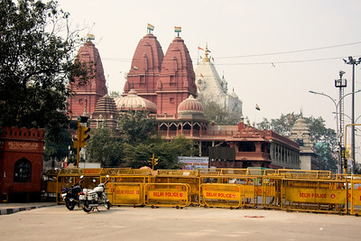 We could see the Sri Digambar Jain Lal Mandir temple across the road as we approached the Red Fort, at Chandni Chowk, Old Delhi. The building was barracaded by the Delhi Police as the city was on full alert after the bombings. It is the oldest and best-known Jain temple in Delhi. I did not know it at the time, but it is also the location of the Charity Birds Hospital an avian veterinary hospital.   Photographed February 2009 - © 2009 Lesley Bray Photography - All Rights Reserved.