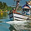 Fishing Trawler cruising on River Sal, Mobor, Goa, India