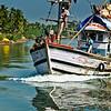 Fishing Trawler cruising on River Sal, Mobor, Goa, India