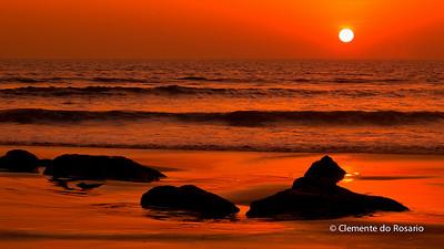Red sunset on Tamborim Beach, South Goa, India