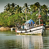 Fishing Trawlers moored on River Sal, Mobor, Goa, India