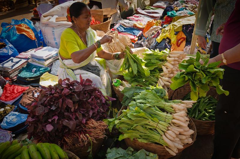 Vegetables vendor at the Mapusa Friday Market, North Goa, India