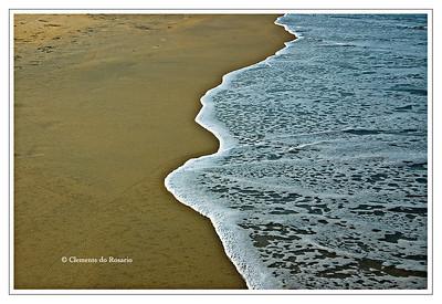 Sea Foam on Varca Beach, Goa, India