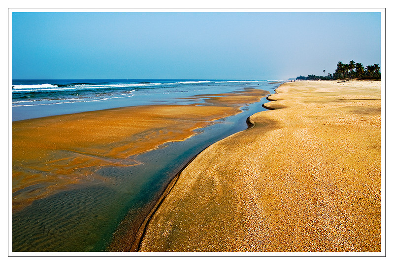 Low tide on Varca Beach Salcette Goa India