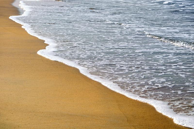 Sea Foam on a beach, Tamborim Goa, India