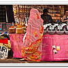 Indian woman in a colourful sari at a spices and tea stall at the Anjuna Flea Market, Goa, India