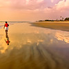 A late evening stroll along Cavelossim beach in Goa, India