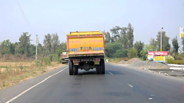 The road to Surat from Navsari. This was recorded on my Nikon D90 through the windshield of the car.