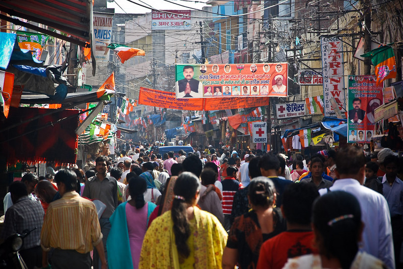 Main street in morning with crowds and pilgrims heading down to the bathing ghat