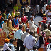 Wedding procession in streets of Haridwar. Groom on the horse. The bride will be waiting at her house.