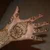 When the henna is first put on, it is dark and crusty