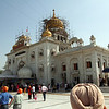 Gurdwara Shri Bangla Sahib, a Sikh temple in New Delhi.<br /> <br /> Gurdwara Shri Bangla Sahib was originally a bungalow belonging to Raja Jai Singh, an Indian ruler in the seventeenth century, and was known as Jaisinghpura Palace.<br /> <br /> The eighth Sikh Guru, Guru Har Krishan resided here during his stay in Delhi in 1664. During that time, there was a smallpox and cholera epidemic, and Guru Har Krishan helped the suffering by giving aid and fresh water from the well at this house. Soon he too contracted the illness and eventually died on March 30, 1664. A small tank was later constructed by Raja Jai Singh over the well, its water is now revered as having healing properties and is taken by Sikhs throughout the world back to their homes.<br /> <br /> The Gurdwara and its Sarovar are now a place of pilgrimage for both Sikhs and Hindus, and a place for special congregation on birth anniversary of Guru Har Krishan and death anniversary of Maharaja Ranjit Singh.