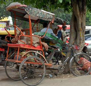 A rickshaw driver takes a nap in Old Delhi