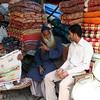 Textile sellers in Chandi Chowk, Old Delhi