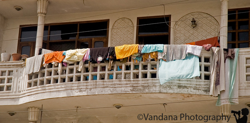 Much of Delhi's houses look like this ! Clothes laid out to dry on balconies, walls, streets everywhere..