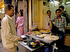 In Paranthewali gali - literally the lane of paranthes - a kind of bread.Established in 1872, the shops here have been making paranthe for more than a century. The photographs inside a tiny, cramped up place include Indian prime ministers eating there, articles in most indian and other magazines..They allow me a photograph.. Only 3 families remain in the business now